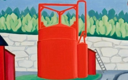 The work by Oscar F. Bluemner depicts three red buildings in front of a bright green and blue landscape