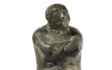 This bronze by Leonard Baskin shows a seated, naked man with his arms folded