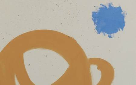 In this abstract work by Adolph Gottlieb, circles float above a cursive mass and one small bright blue burst straddles the divide.