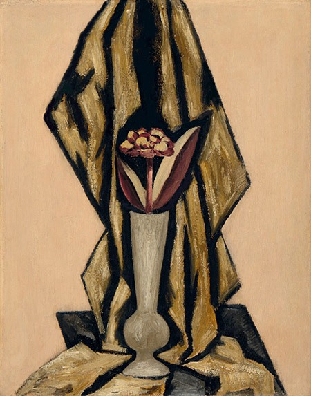 In this work by Marsden Hartley, a tall narrow vase is framed by the folds of the curtain behind it