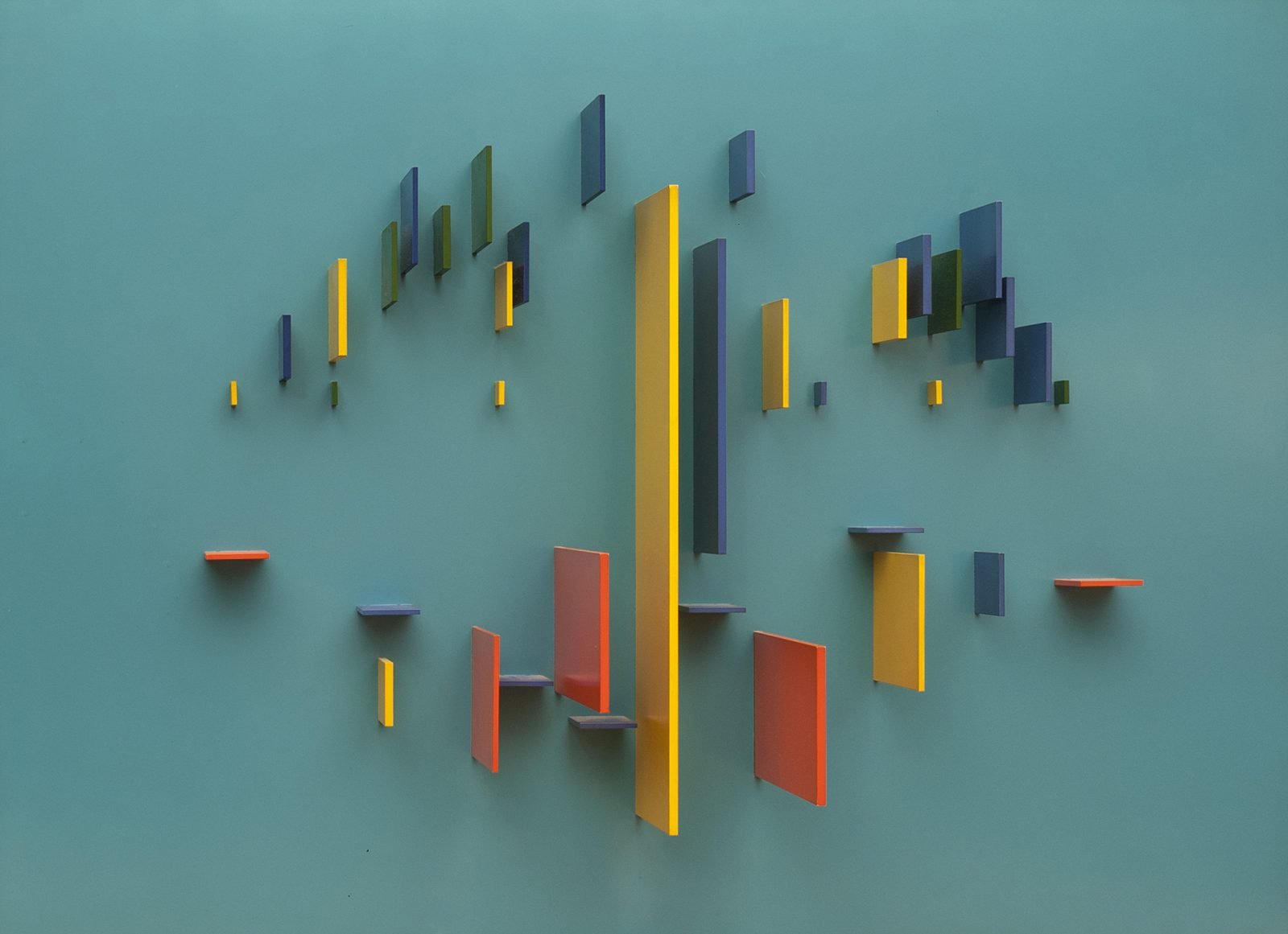 This work by Charles Biederman is a yellow, green, blue and red relief on a blue background