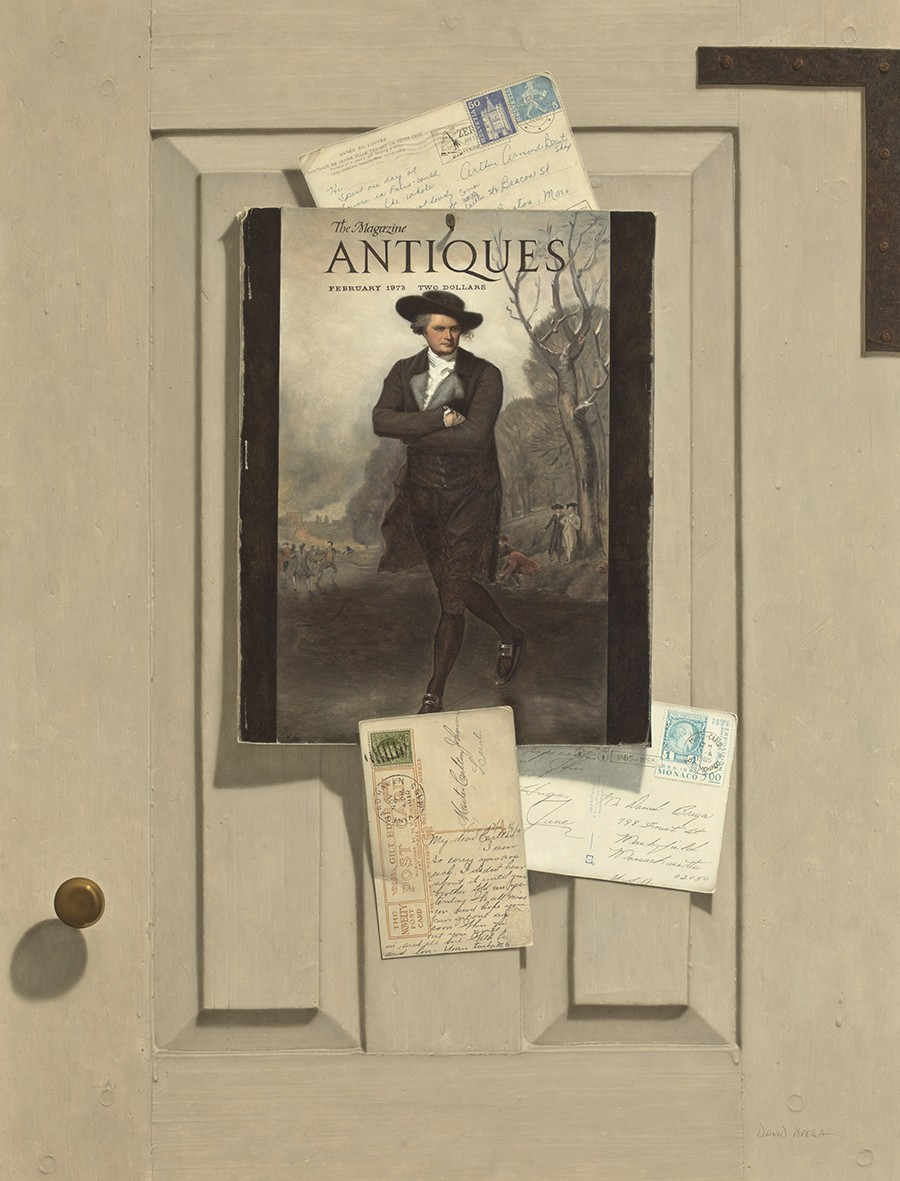 A magazine and a few postcards are shown pinned to a door