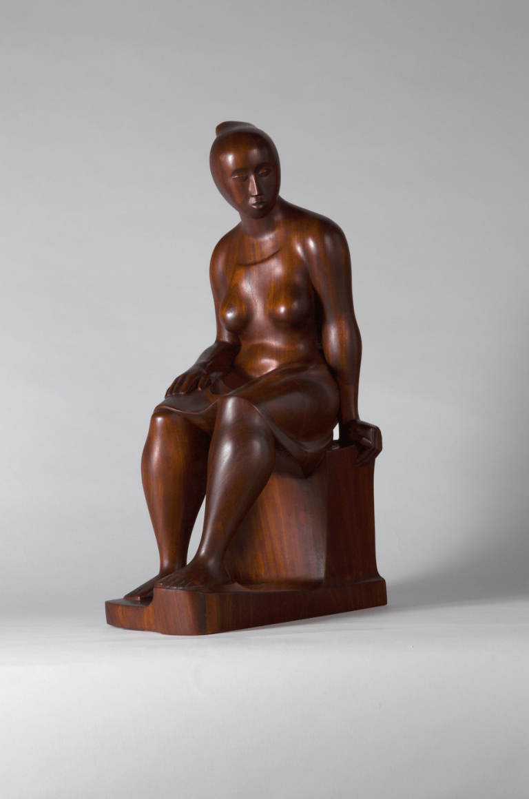 A mahogany sculpture by Elizabeth Catlett of a woman seated.