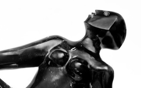 This sculpture by Elizabeth Catlett shows a woman on her back, looking up