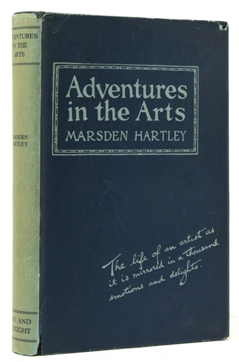 """Marsden Hartley's book """"Adventures in the Arts"""", with a blue cover and light green spine."""