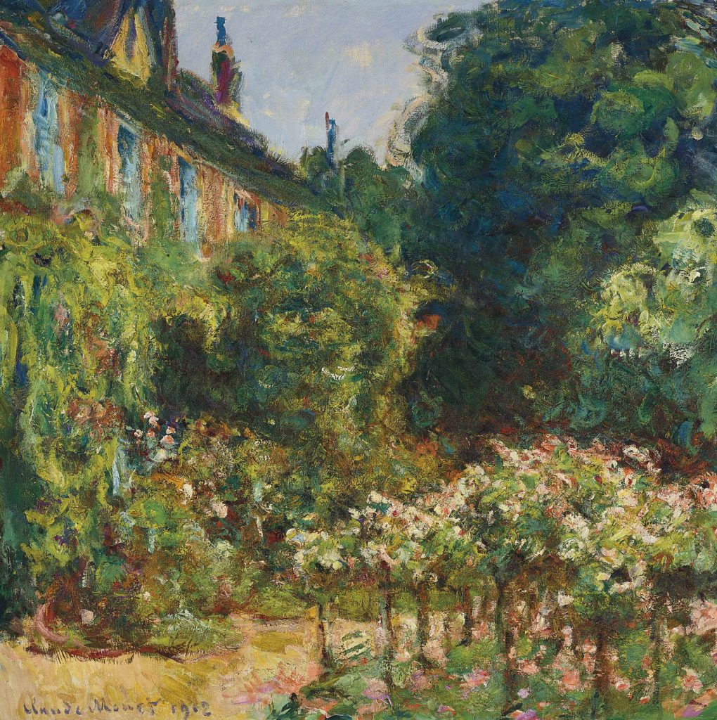 The lush, green garden in front of Claude Monet's home.