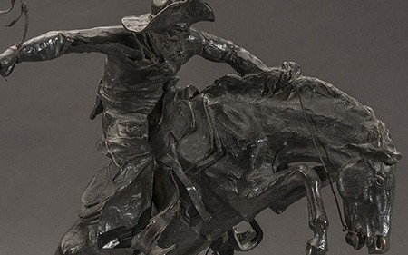 This work by Frederic Remington captures the perilous scene of a rugged cowboy breaking a wild, rearing horse.