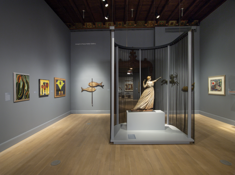 Installation view of the exhibition Edith Halpert and the Rise of American Art featuring a sculpture surrounded by netting.