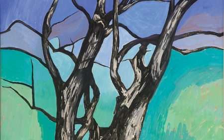 This work by Charles Sheeler shows a dead tree in front of a bright blue and green background.