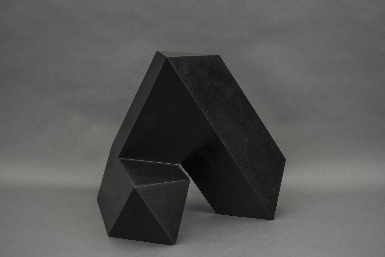 """Spitball"" is an abstract, black, geometric sculpture made of ebony granite"