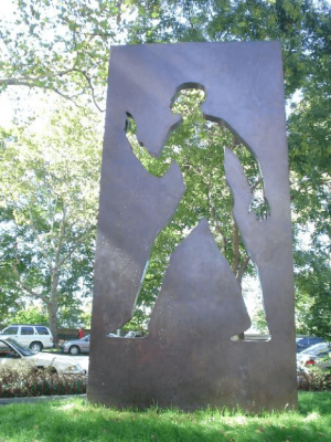 Bronze memorial for author Ralph Ellison, featuring a cut-out of an adult man, by Elizabeth Catlett in New York.