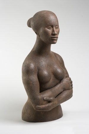 This sculpture by Elizabeth Catlett shows a simplified bust and portrait of Joan Sandler
