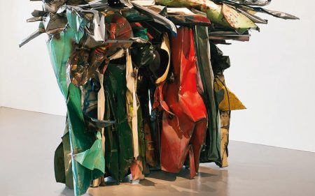John Chamberlain's large metal sculpture formed of deformed car parts.