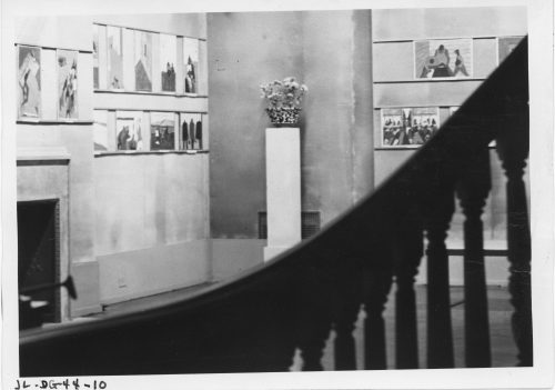 Black and white photograph showing Edith Halpert's gallery in 1941, with some of Jacob Lawrence's works hung on the walls