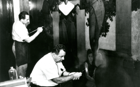 Hilly Shar, father of current Lowy President Larry Shar, kneels while restoring the Old King Cole painting at the St. Regis Hotel, New York, New York.