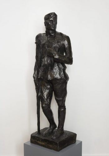A bronze sculpture of a wounded solider.
