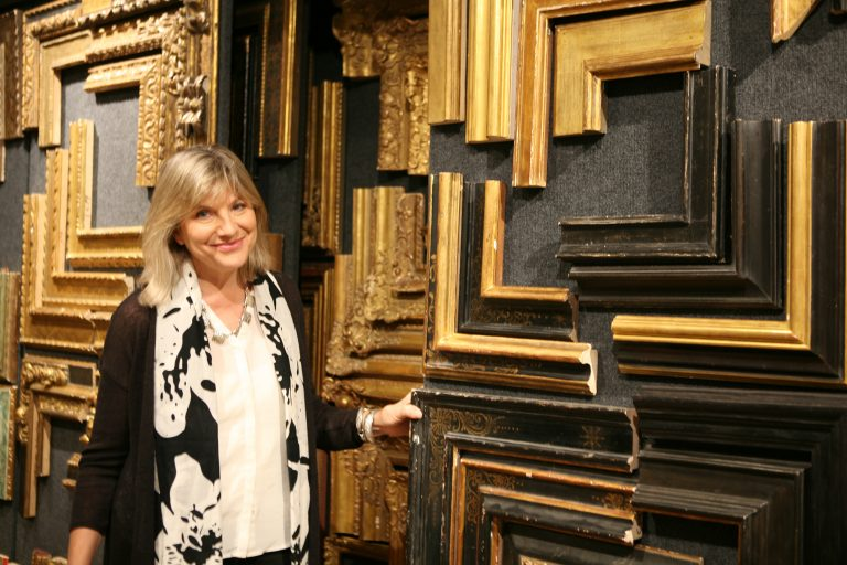 Lowy Vice President of Sales Lisa Wyer poses with a selection of frame ends in Lowy's Manhattan showroom.